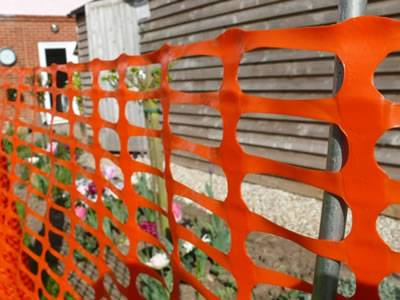 Orange safety barrier with flat oriented surface for high visibility.