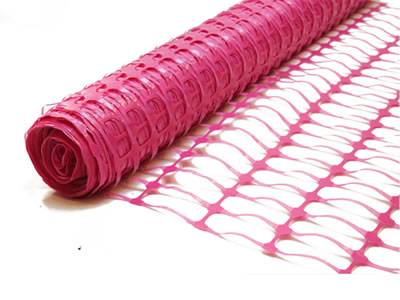 Pink plastic barrier mesh with oval opening.