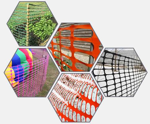 Plastic temporary barrier mesh used as snow fence, barrier and garden fence.