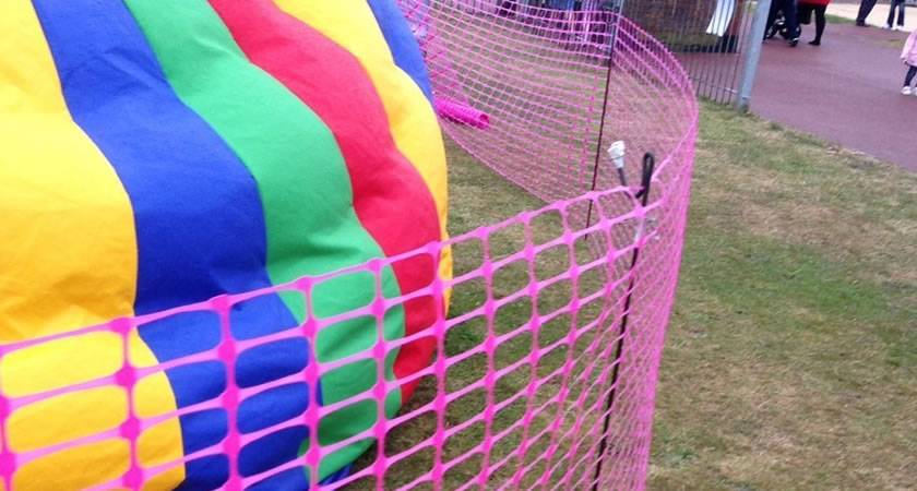 Pink barrier mesh at sport event.