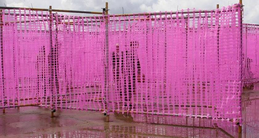 Attractive pink barrier fencing for an event.