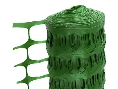 Green extruded plastic barrier fence with oval opening.